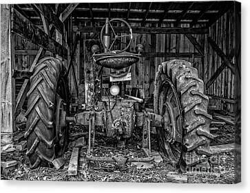 Old Tractor In The Barn Black And White Canvas Print by Edward Fielding