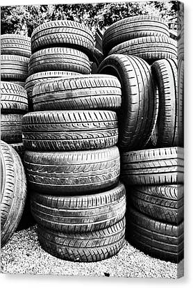 Old Vehicle Tyres Canvas Print by Tom Gowanlock