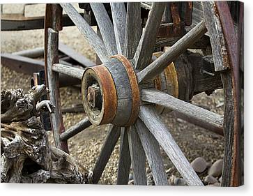 Canvas Print featuring the photograph Old Waagon Wheel by Phyllis Denton