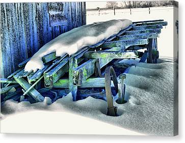 Old Wagan In The Snow Canvas Print