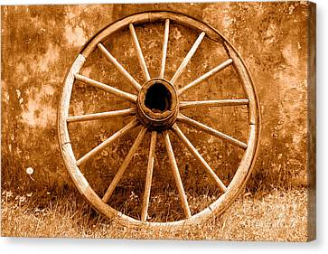 Old Wagon Wheel - Sepia Canvas Print by Olivier Le Queinec