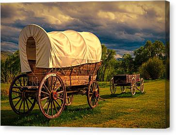 Old Wagons Canvas Print by Maria Coulson