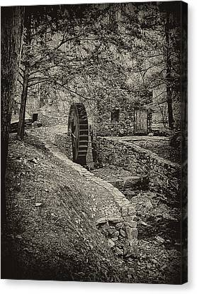 Old Water Wheel Canvas Print by Bill Cannon