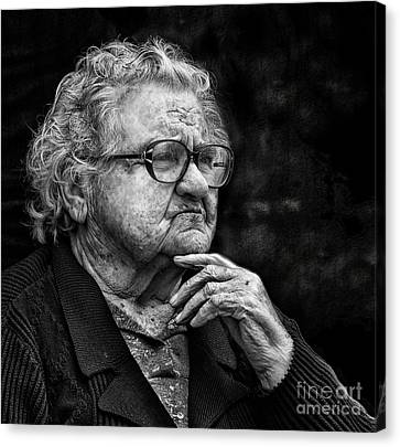 Old Woman Lost In Thought Canvas Print by Stephan Grixti