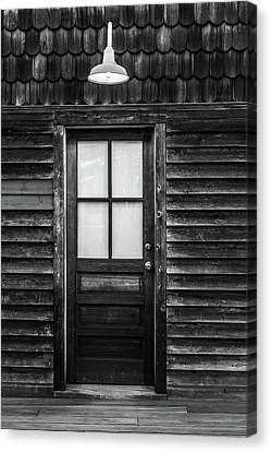 Canvas Print featuring the photograph Old Wood Door And Light Black And White by Terry DeLuco