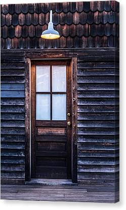 Canvas Print featuring the photograph Old Wood Door And Light by Terry DeLuco