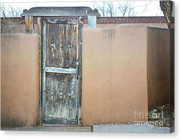 Canvas Print featuring the photograph Old Wooden Door Adobe by Andrea Hazel Ihlefeld