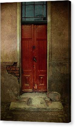 Old Wooden Gate Painted In Red  Canvas Print by Jaroslaw Blaminsky