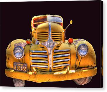 Old Yellow Dodge Canvas Print by Peter Schumacher