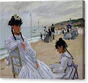 On The Beach At Trouville Canvas Print by Claude Monet