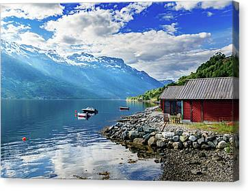 Canvas Print featuring the photograph On The Beach Of Sorfjorden by Dmytro Korol