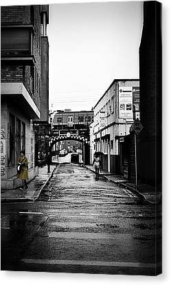 The Rail And The Green Raincoat Canvas Print