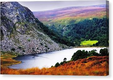 On The Shore Of Lough Tay. Wicklow. Ireland Canvas Print by Jenny Rainbow