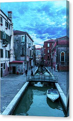 one of many normal channels of Venice on a summer evening Canvas Print by George Westermak