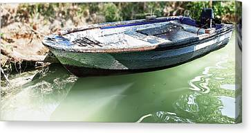 One Small Boat Canvas Print by Svetlana Sewell