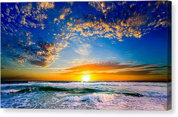 Canvas Print featuring the photograph Orange And Blue Sunset Sun Setting Over The Ocean by Eszra Tanner