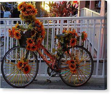 Orange Flower Bike Canvas Print by Laurie Perry