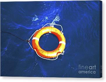 Orange Life Buoy In Blue Water Canvas Print by Jacki Costi