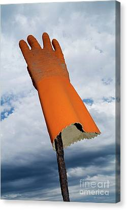 Orange Rubber Glove On A Wooden Post Against A Cloudy Sky Canvas Print by Sami Sarkis