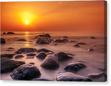 Orange Sunset Long Exposure Over Sea And Rocks Canvas Print by Sandra Rugina