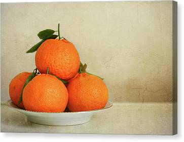 Oranges Canvas Print by Annfrau