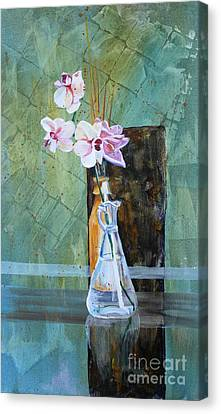 Orchids And A Rose Canvas Print by Janet Felts