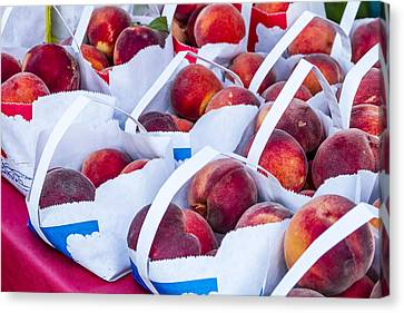Organic Peaches At The Market Canvas Print by Teri Virbickis