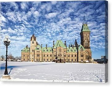 Snow Flag Canvas Print - Ottawa Parliament East Block by Jane Rix