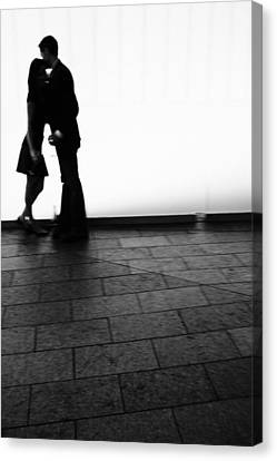 Out Of Focus Couple Kissing Canvas Print by Gillham Studios