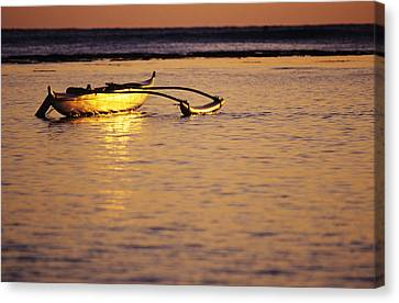 Outrigger And Sunset Canvas Print by Joss - Printscapes