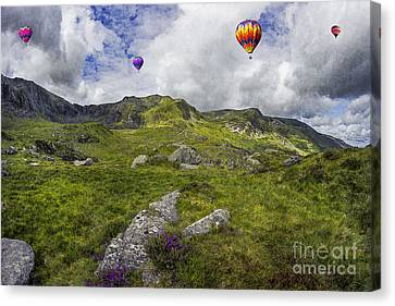 Over The Mountains Canvas Print by Ian Mitchell