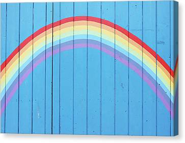 Painted Rainbow On Wooden Fence Canvas Print by Richard Newstead
