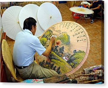 Canvas Print featuring the photograph Painting Chinese Oil-paper Umbrellas by Yali Shi