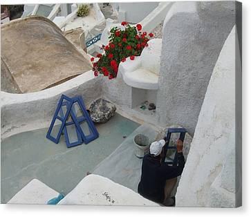 Painting Shutters In Santorini Greece Canvas Print by Nikki Borden