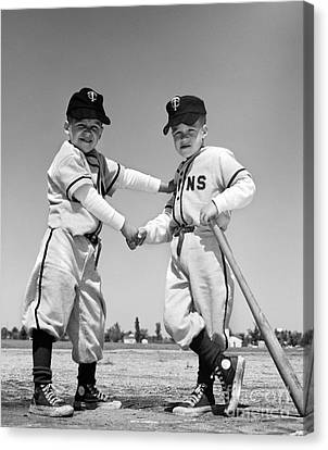 Pair Of Little Leaguers In Uniform Canvas Print by H. Armstrong Roberts/ClassicStock