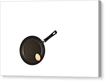 Pan With Egg Canvas Print by Gert Lavsen