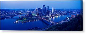 Panoramic Evening View Of Pittsburgh Canvas Print by Panoramic Images