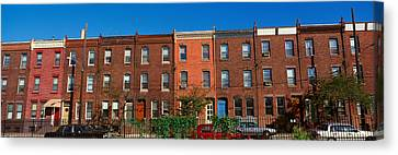 Panoramic Morning View Of Red Brick Row Canvas Print by Panoramic Images