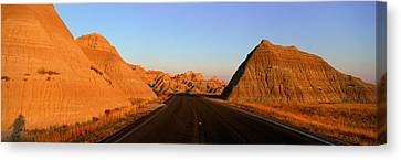 Panoramic View Of Road Going Canvas Print by Panoramic Images