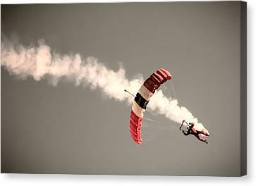 Parachuting In Canvas Print by Martin Newman