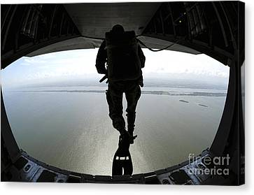 Pararescuemen Train On The Banana River Canvas Print by Stocktrek Images