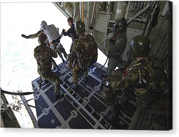 Paratroopers Jump From A C-130 Hercules Canvas Print by Andrew Chittock