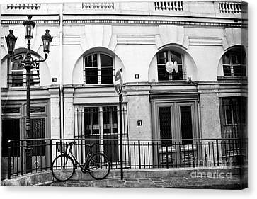 Canvas Print featuring the photograph Paris Bicycle Street Lanterns Architecture Black And White Art Deco - Paris Black White Home Decor by Kathy Fornal