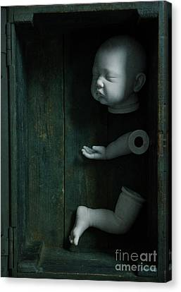 Canvas Print featuring the photograph Parts Of A Plastic Doll In A Wooden Box by Lee Avison