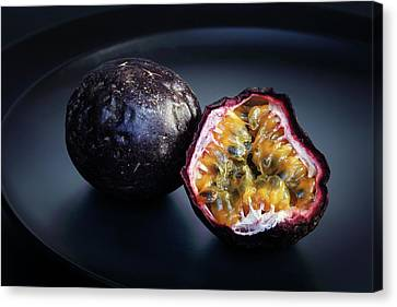 Passion Fruit Canvas Print - Passion Fruit On Black Plate by Johan Swanepoel