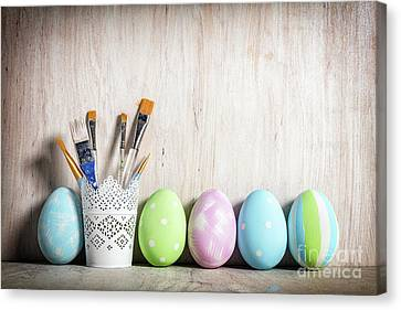 Pastel Easter Eggs And Brushes In A Rustic Cup Canvas Print by Michal Bednarek