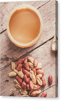 Peanut Butter Jar With Peanuts On Wooden Surface Canvas Print