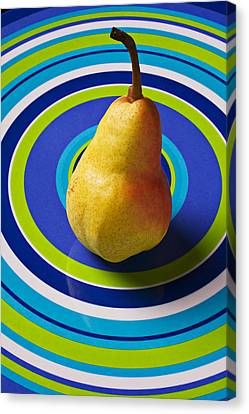 Pear On Plate With Circles Canvas Print by Garry Gay