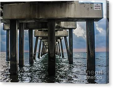 Peering Beneath The Pier Canvas Print by Gary Keesler
