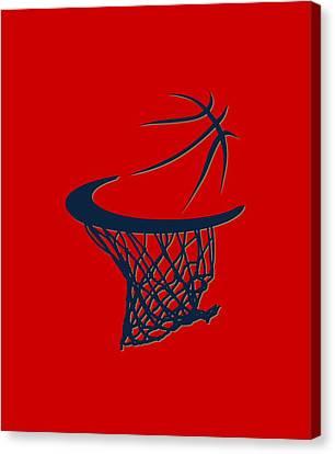 Pelicans Basketball Hoop Canvas Print by Joe Hamilton